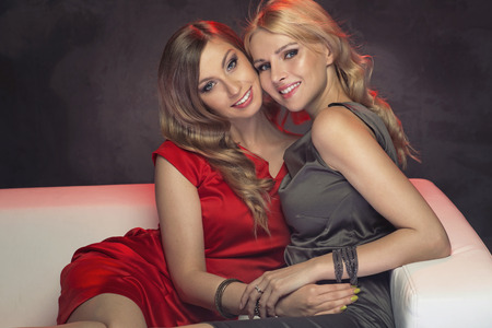 sensual lips: Portrait of the two beautiful sisters