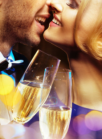 lovely couple: Closeup portrait of the couple drinking a champagne Stock Photo