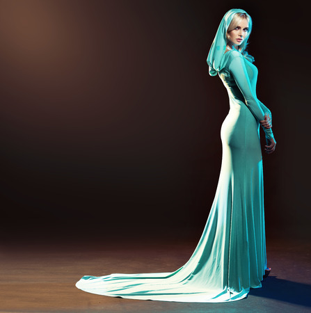 evening gown: Blond alluring woman dressed in evening gown Stock Photo