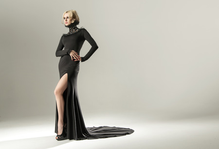 glamour woman elegant: Stunning blond woman wearing elegant black gown
