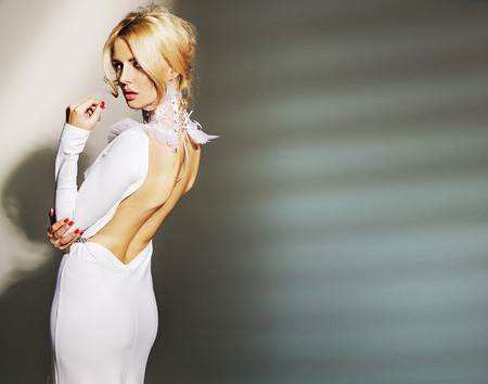 Stunning young lady wearing white gown