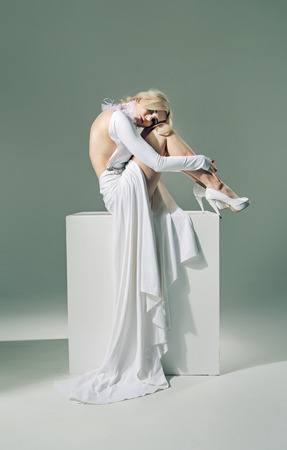 fascination: Half nude woman wearing white gown Stock Photo