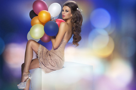 Portrait of the sensual woman with balloons photo
