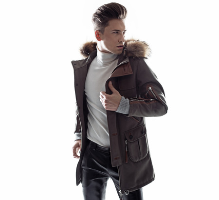 Smart young guy wearing trendy winter jaket photo