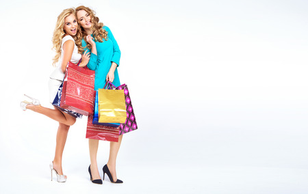 Two attractive ladies on the shopping photo