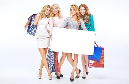 Fabulous girlfriends holding an empty board photo