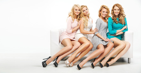 Four attractive women posing together photo