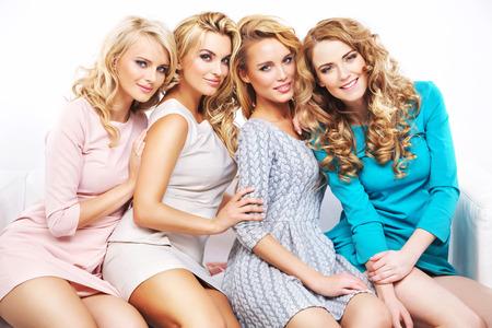 Closeup portrait of the four joyful girlfriends photo