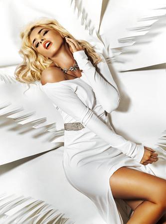 white sheet: Fabulous young lady lying on white sheet