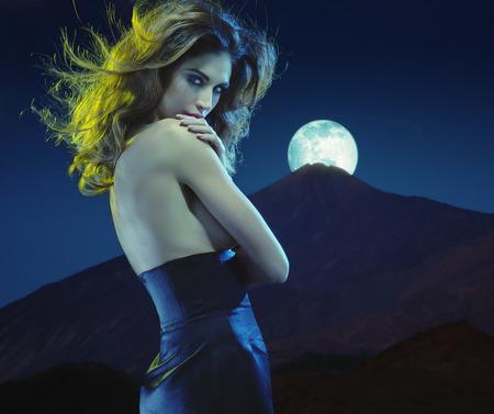 sensual nude: Seductive young woman at moonlight