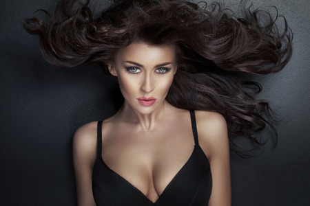 cleavage: Alluring woman looking at the camera