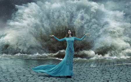 wind storm: Alluring, elegant lady over the sand&water storm Stock Photo