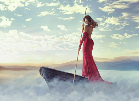 stunning: Alone smart woman paddling in the clouds