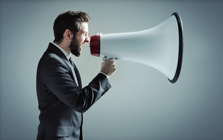 angry businessman: Conceptual photo of manager yelling over the megaphone