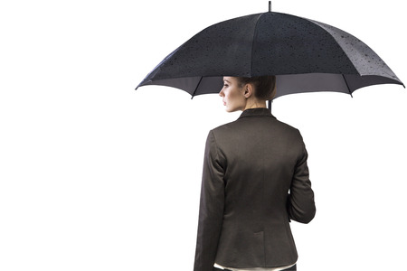 pessimist: Attractive young businesswoman holding an umbrella Stock Photo