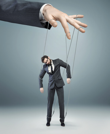 impotent: conceptual photo of a boss pulling the strings