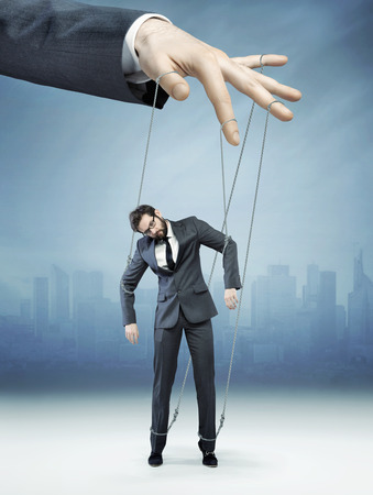puppet master: Conceptual photo of controlled employee