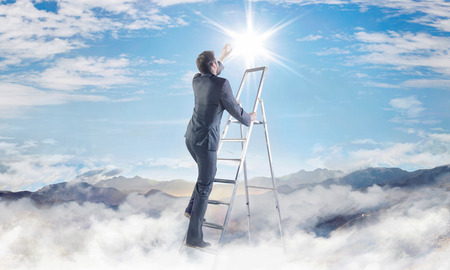 corporate ladder: Conceptual picture of young businessman achieving a success