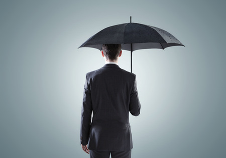 Conceptual picture of the depressed businessman Stock Photo
