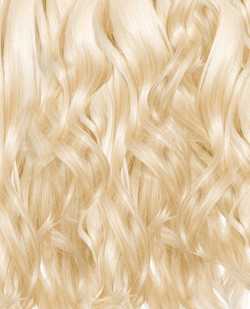 blonde streaks: Picture presenting a blond curly hairpiece