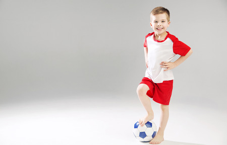 plimsoll: Cute kid playing the soccer