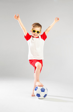 plimsoll: Cute little man playing football
