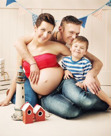 large family portrait: Portrait of the happy family expecting a new member