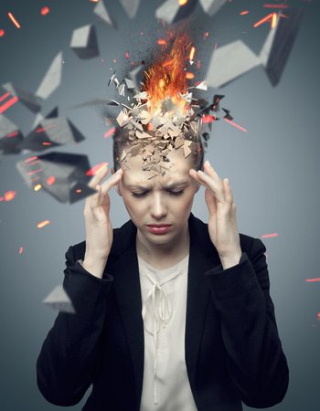head pain: Smart businesswoman with exploding headache