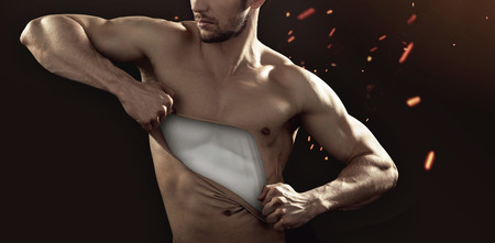 black t shirt: Muscular guy pulling his chest skin away