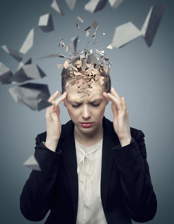 Smart businessman with a huge migraine