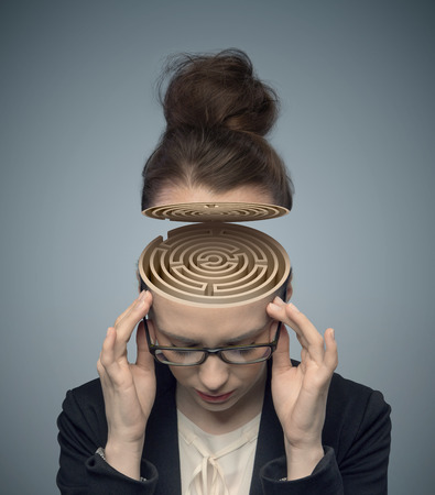people human mind: Conceptual image of a labyrinth in the woman Stock Photo