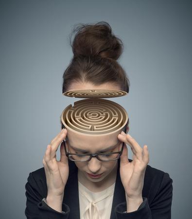 Conceptual image of a labyrinth in the woman Foto de archivo