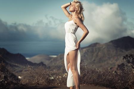 sunbath: Sensual blond lady taking the sunbath
