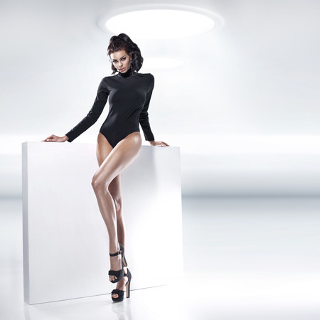 tempting: Fashion shot of brunette lady with tempting body