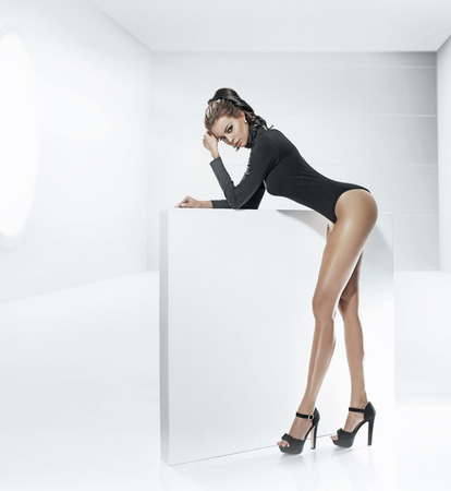 long legs: Young tawny woman with tempting long legs Stock Photo