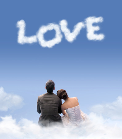 nearness: Young marrried couple sitting on the clouds Stock Photo