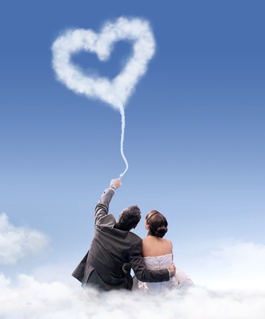 nearness: Just married couple sitting on the flossy cloud Stock Photo
