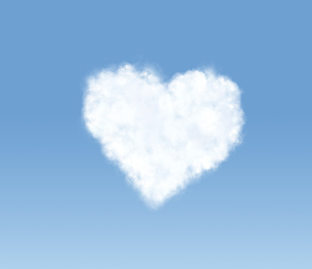 Heart-shaped cloud in the blue sky photo