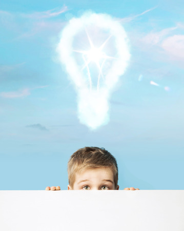 freedom of thought: Little boy with a light bulb above head