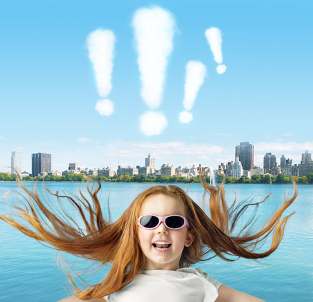 cloud shape: Ginger child with exclamation marks above Stock Photo