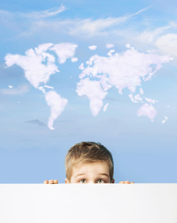above head: Portrait of a child with world map above head Stock Photo