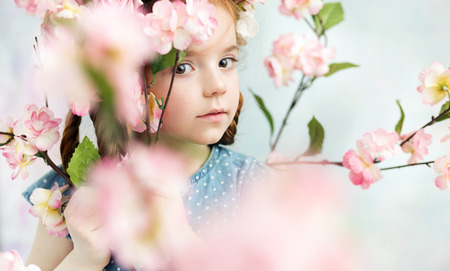 ginger flower plant: Little girl holding a colorful branch Stock Photo