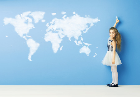portrait young girl studio: Little child drawing a world map