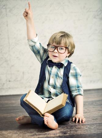 novel: Clever boy reading an interesting novel