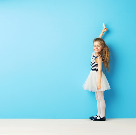 ballet studio: Cute child writing on the wall with chalk