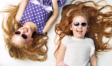 school playground: Pretty little girls having a great fun together Stock Photo