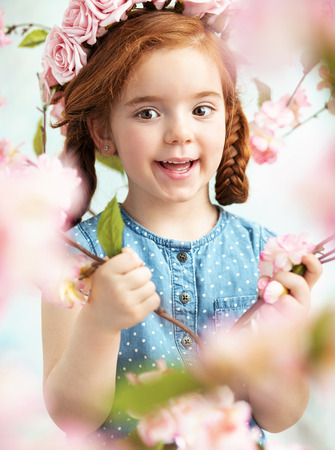 ginger flower plant: Cheerful litlle lady holding a branch