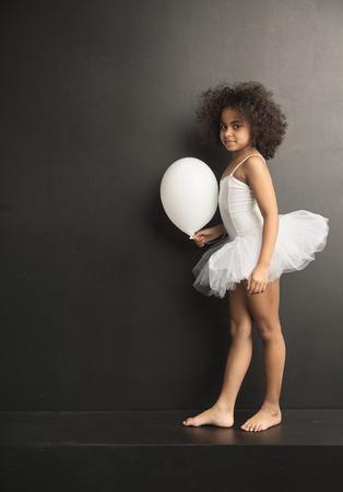 ballet studio: Conceptual picture of a little ballet dancer with a white ballon