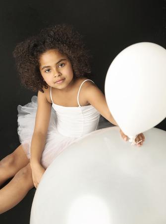 ballet studio: Cute little girl holding a balloon Stock Photo
