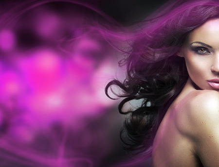 smile girl: Conceptual picture of a brunette lady with a purple light